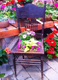 flowers sitting on chairs | Perfect idea for chair left from old set, that was to pretty to throw ...
