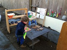 Outdoor mud pie kitchen for kids-complete with flag-stone stove and a tile cutting board!
