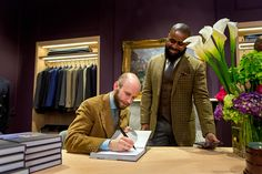 "Simon signing a book for Earl Rich of MaleStylePro. Simon was in Toronto to sign copies of his book ""The Finest Menswear in the World"" as well as talk all things sartorial with passionate clothing connoisseurs at the city's new destination for classic style, LeatherFoot Emporium."