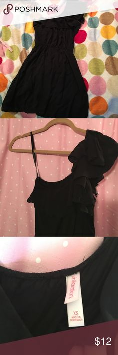 Dress Cute one shoulder black mini dress from Target.  Cinched at waist.  Size XS but I wear a medium and it fits me. 100% Rayon. Dresses Mini