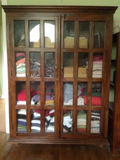 Tall glass-front shelves; Dimensions: 53 in wide, 17 in deep, 70 in tall