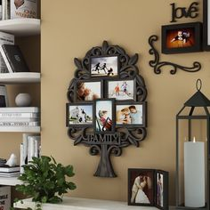 """Proudly display photos of your parents, cousins, siblings, and children with this adorable family tree picture frame! Made from molded plastic in a classic black finish, this design features a tree-shaped outer frame with scrollwork branches and slender leaves – the word """"family"""" cut out in bold print at the trunk. Clustered within the branches, six picture frames with decorative moldings hold your favorite 4"""" x 6"""" pictures under UV glass. Measuring 25.8"""" H x 17.4"""" W overall, this piece ... Pallet Picture Frames, Hanging Picture Frames, Collage Picture Frames, Picture Frame Sets, Hanging Pictures, Family Tree Picture Frames, Family Tree With Pictures, Family Tree Photo, Family Tree Art"""