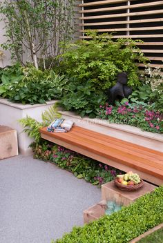 Nice simple bench in a pretty Garden setting. Foliage Garden & patio, raised beds, with wooden bench, blanket