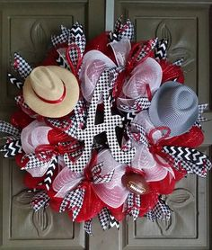 "This is a beautiful 24"" Alabama Crimson Tide deco mesh wreath. It is made of red and white deco mesh and accented with Alabama houndstooth ribbons, white mesh ribbon, and black and white chevron ribbo"