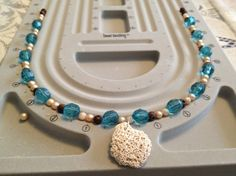 How to Make A Shell Necklace from a Vacation Souvenir & Old Beads