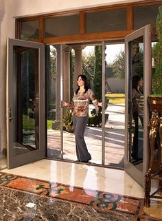 Install french doors w/ sliding screen doors for the Screened Porch turned into Den.