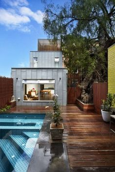 This block of art deco flats in South Yarra conceal a beautiful Modscape extension. See more now.