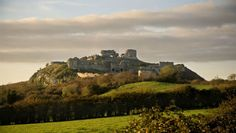 ROCK OF DUNAMASE - The Vikings pillaged it in 842. In the 12th century, when the Normans arrived in Ireland, it became one of the most important Anglo-Norman strongholds in Laois. It was part of Aoife's (daughter of Diarmuid Mac Murrough, King of Leinster) dowry, when she was given in marriage to Norman conqueror Strongbow in 1170. When Isabel, daughter of Strongbow and Aoife, wed William Marshal, Earl of Pembroke, Dunamase was given as part of her marriage's wedding gift.