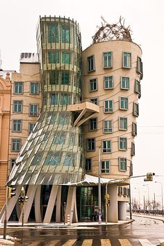 Dancing House or Fred & Ginger Building by Frank Gehry ~ Prague, Czech Republic. originally named Fred and Ginger (after Fred Astaire and Ginger Rogers, the house resembles a pair of dancers) the house stands out among the Baroque, Gothic and Art Nouveau buildings for which Prague is famous.
