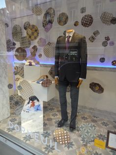 New shop window display for April in Rue François 1er with its soaring motif of Ottoman ceramics #dormeuil #dormeuilmode #shopwindow #mensfashion #fashion #collection