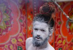 An ash smeared Hindu Sadhu or holy man poses beside a tent in Allahabad, on December ahead of The Maha Kumbh Mela. Kumbh Mela, Male Poses, Hinduism, Body Painting, Human Body, Religion, The Incredibles, Earth, Culture