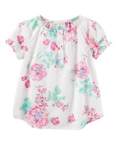 This sweet summer top features bow details at the sleeves and an allover floral print that can easily be complemented by lace-detailed shoes and a simple pair of shorts.