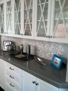Kitchen , Glass Mosaic Backsplash For Kitchen : Pearl Glass Mosaic Backsplash With Solid Grey Countertop And White Cabinets