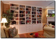 My 12 year dream is about to come true... ceiling to floor custom bookcase/cabinets.  This picture is similar.  Not white though.