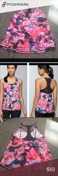 Lululemon Secret Garden tank 8 floral/roses Missing size tag but I think it is an 8. Chest 17 inches. Length 26 inches. Supposed to be a flowing type fit so could fit a 4-6-8. Never worn. lululemon athletica Tops Tank Tops