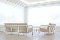 Waiting area with STUA Malena sofa with white frame. The horizontal slats of the…