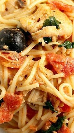 Tuscan Chicken Pasta Recipe - saucy pasta dish with chicken, spinach, tomatoes, olives, mushrooms and angel hair pasta.