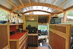 This is great. The owner took a van and re-did the roof to spread out beyond the sides and created a super cool space.