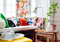 Colourful couches and matching curtains can brighten up a bay window