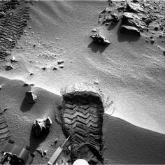 "Looking very similar to the iconic first footprint on the Moon from the Apollo 11 landing, this new raw image from the Curiosity rover on Mars shows one of the first ""scuff"" marks from the rover's wheels on a small sandy ridge. This image was taken today by Curiosity's right Navcam on Sol 57 ("