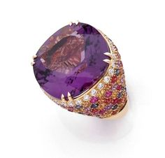 Margherita BURGENER ~Ring in yellow Gold adorned with a cushion-cut Amethyst (27,90ct), pavé brilliant-cut Diamonds and multi-coloured Sapphires. Signed. Sold for 4,547€