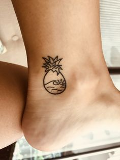 Wave and sunset in a pineapple tattoo I got in Antigua!
