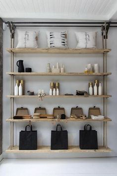 Flexible Ways To Decorate With Hanging Shelves. Another interesting mix of pipes and rope hanging shelves Rustic Wood Shelving, Wood Shelves, Custom Shelving, Modern Shelving, Shelving Ideas, Shelf Ideas, Industrial Bookshelf, Shelving Units, Desk Shelves