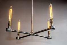 Steel conduit hanging chandelier with vintage light bulbs  on Etsy, $272.61 CAD