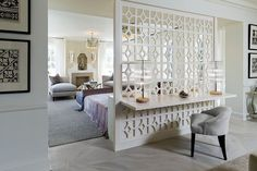 Smart way to separate the master bedroom rom bath even while creating a workspace [From: Kimberley Seldon Design Group]