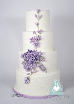 Pretty Lilac Flowers on White Wedding Cake #WeddingCakes www.finditforweddings.com