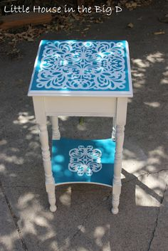 Side table with laser cut scrapbook paper as a stencil.