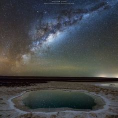This image was made in the Lagunas Baltinache, located in the Salar de Atacama, Atacama Desert, Chile. In the middle of the salt desert there are seven small lagoons of transparent water that at night serve as a mirror to one of the most beautiful skies in the world. Stitched vertical panorama of 3 images taken at the same time. Images only with color and contrast corrections.