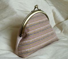 My first bag made with a piece of my own woven silk! © Diane Shaw Silks can now be purchased here: https://www.etsy.com/uk/listing/257823403/handwoven-pink-gold-white-silk-clutch?ref=shop_home_active_4