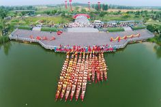 Dragon boats prepare to set off on the annual race along a river in China's Shandong province. Dragon boat racing dates back over years and has now developed into a serious sport in many countries across the globe. Dragon Boat Festival, Chinese Dragon, Festivals, Dates, Countries, Globe, Racing, China, River