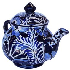 A Mediterranean talavera coffee pot belongs to our rustic home decor category. Its blue pattern painted over white background will add personality to the living space. by Rustica House #myRustica