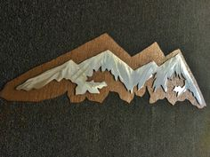 Celebrate someone who loves the mountains with this metal wall artwork. It truly makes the perfect gift!