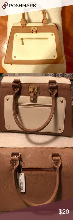 NWT Charming Charlie Gold  Locket Purse NWT! Purse has never been used. Tan and cream medium  size purse is a great accent for a casual or professional look. Purse does come with a shoulder strap and gold accents. Charming Charlie Bags Shoulder Bags