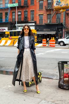 Ulla Johnson dress, Staud crop top, Rosie Assoulin coat, Jimmy Choo sandals, Rejina Pyo sunglasses