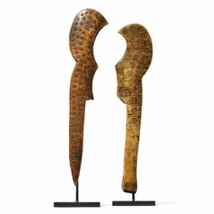 Two Lega ceremonial knives, Democratic Republic of the Congo one carved from elephant (loxodonta africana) bone, the other from elephant (loxodonta africana) tusk, of flat, hooked form with incised circle and dot motifs; fine reddish brown to creamy white patina. length of longest 9 3/8 in. 23.8 cm