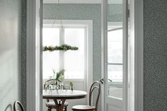 Our design team imagined sheer summer curtains, fluttering butterfly wings and the warm and lovable spring sun. The result, VILLA DALARÖ, has become a reference book of country wallpapers. Home Look, Dining Room Decor, Relaxing Bedroom, Scandinavian Wallpaper, Summer Curtains, Home, Gray Interior, Kitchen Wallpaper, Dining Room Wallpaper