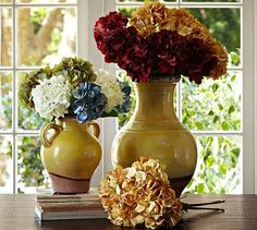 Subtle color variations on each petal give the Faux Hydrangea Stem its realistic, natural look. Place it in a glass vase as fresh accent on a coffee table or console, or even on a desktop to create a cheerful place to work. Bottles And Jars, Over The Rainbow, Natural Looks, Autumn Leaves, Pottery Barn, Glass Vase, Sweet Home, Table Decorations, Hydrangeas
