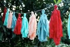 Super cute fabric tassle garland! Tutorial here: http://prudentbaby.com/2011/07/prudent-home/how-to-make-a-fabric-tassel-garland-no-sew-2/