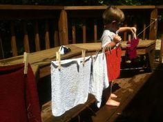 outdoor pretend play -- clothesline