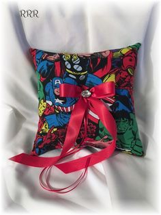 Fun ring pillow in an Avengers theme.... great addition to your superhero theme wedding.  #weddings2016 #avengerswedding