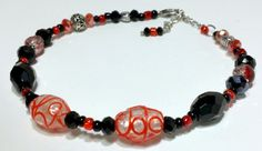 Beaded Ankle Bracelet, Black, Red and Silver beaded anklet. 9 and 1/2 inches but extends to 11 and 1/2.Graduated style single strand.