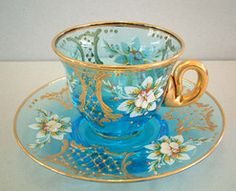 I want it.  Blue glass withe flowers and gold tea/cup and saucer