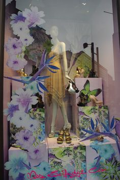 love the cutout flowers and boxes decorated with floral images-Miss Selfridge window display.