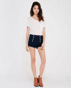 "<p>A pair of super chic high-rise sailor shorts from Almost Famous™ featuring a soft knit body, front button detail, faux back pockets, a cuffed hem, and a stretchy fit.</p>  <p>Model wears a size small.</p>  <ul> <li>High-Rise</li> <li>8-Button Closure</li> <li>2.5"" Inseam</li> <li>Rayon / Nylon / Spandex</li> <li>Machine Wash</li> <li>Imported</li> </ul>"
