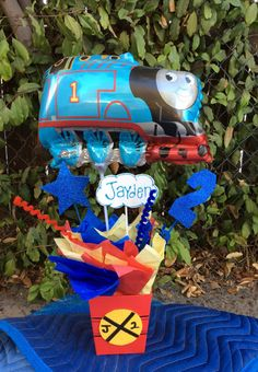 Thomas the Train Theme Party centerpiece! Are you having Thomas the Train party? Handmade centerpiece with the cute Thomas the Train balloon. This listing is for 1 Thomas the Train birthday centerpiece. Thomas Birthday Parties, Thomas The Train Birthday Party, Trains Birthday Party, Train Party, Birthday Party Themes, Birthday Ideas, Third Birthday, Boy Birthday, Birthday Party Centerpieces