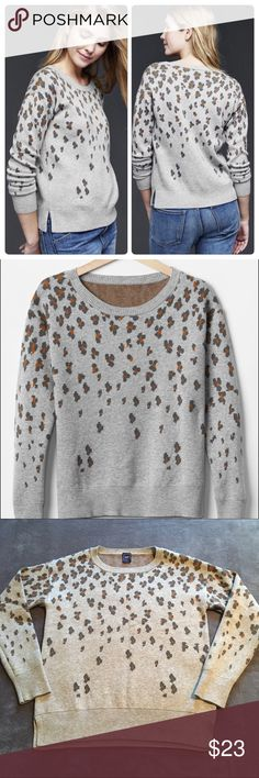 GAP Brooklyn Animal Print Sweater A must-have for fall and winter! This GAP Brooklyn sweater is such a quality piece and so easy to wear for work or a weekend outing. Light gray with dark gray and pumpkin orange cheetah print. Soft merino wool blend (55% nylon, 30% merino extra fine wool, 15% acrylic), medium weight. Excellent condition, only worn twice. I love this sweater but sadly my skin can't tolerate the wool. ❌No trades GAP Sweaters Crew & Scoop Necks